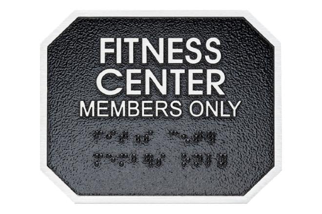 ADA Room cast metal plaque